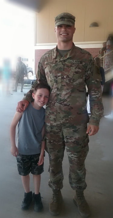 Logan Castello, pictured in uniform with his younger brother.