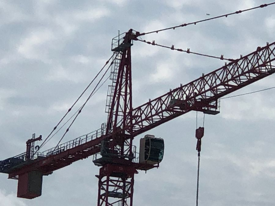 One of the cranes involved in a collision at an east Austin construction site Sept. 16, 2020 (KXAN Photo/Frank Martinez)