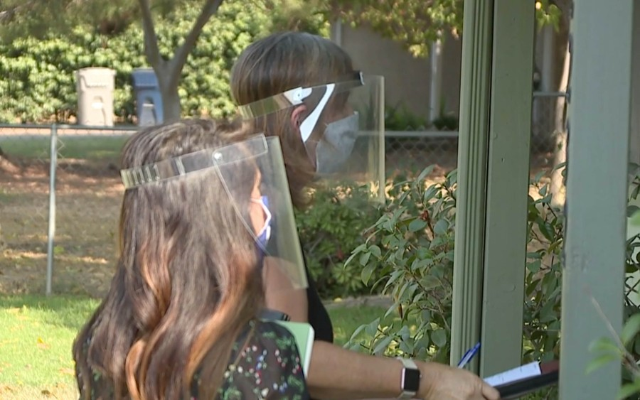 Laurie Butler and Elisa Olmo attempting to get a current address for students (KTXL Photo)