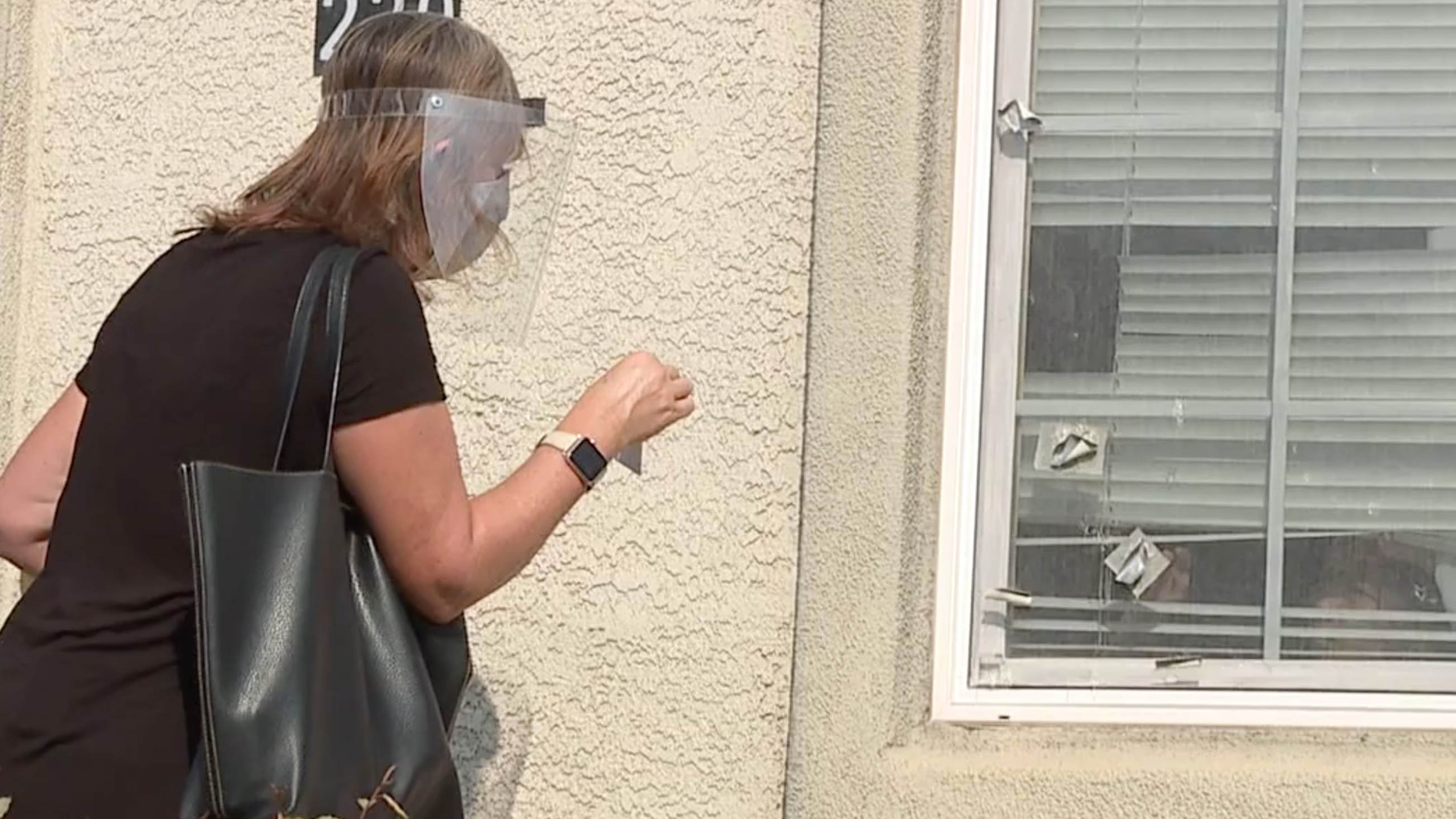 Laurie Butler identifying herself as she tries to search for a student (KTXL Photo)