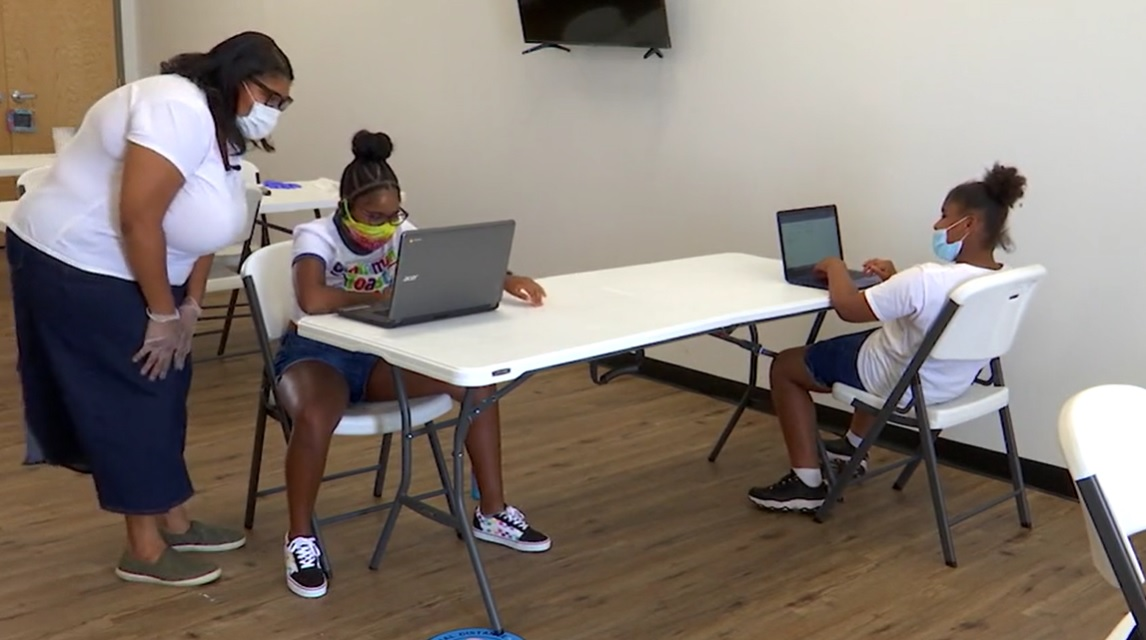 Students work on online schooling at the Virtual School Care Center in Richmond, Virginia (WRIC Photo/Kerri O'Brien)