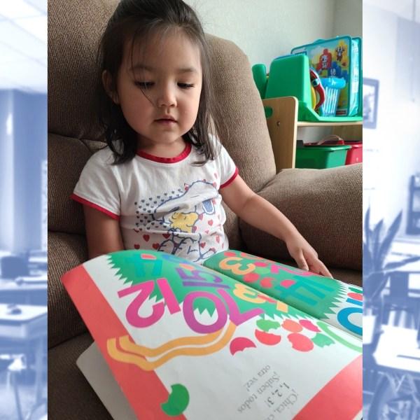 Nayeli Trevino, 3, reading a book (Courtesy Annabel Trevino)