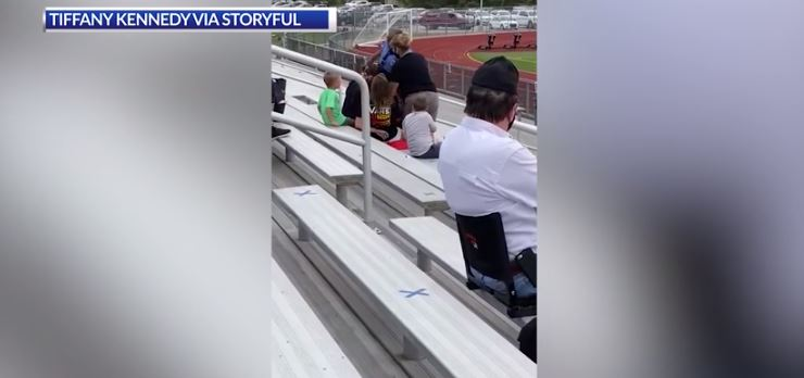 A woman was removed from the stands at an Ohio middle school (Tiffany Kennedy via Storyful)