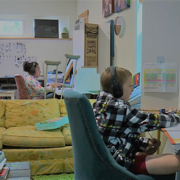 Students work on virtual lessons in a learning pod created in a South Austin home. (KXAN Photo/Ben Friberg)