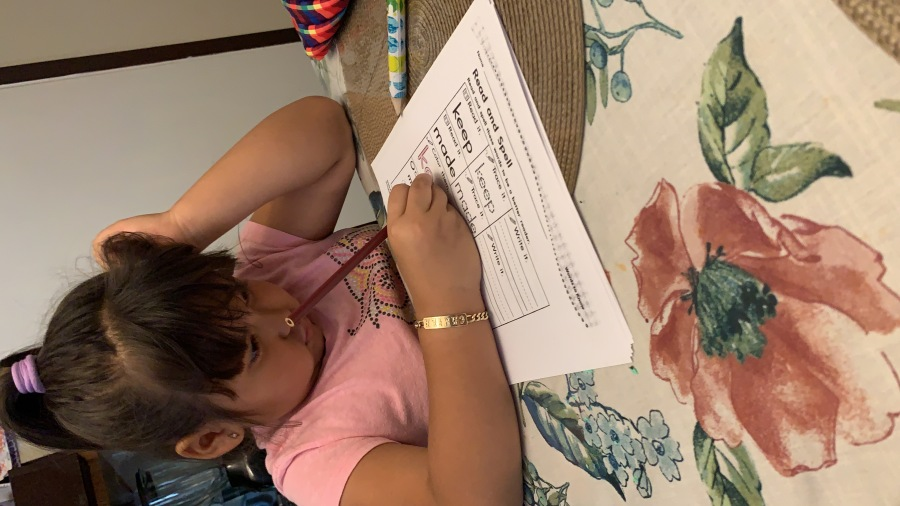 Camila Luevano studies at her family's kitchen table (KXAN Photo)