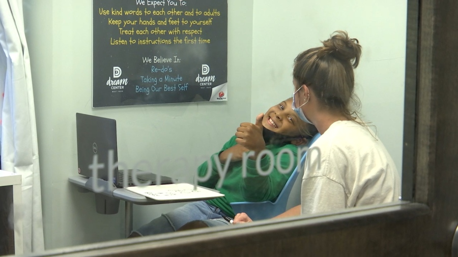 A student spends some time with a volunteer in the therapy room (WKRN Photo)