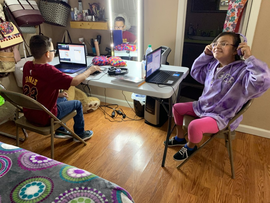 Twins Alexander and Ruby Luevano each have a laptop to join their fourth-grade classes online (Courtesy Luevano family)