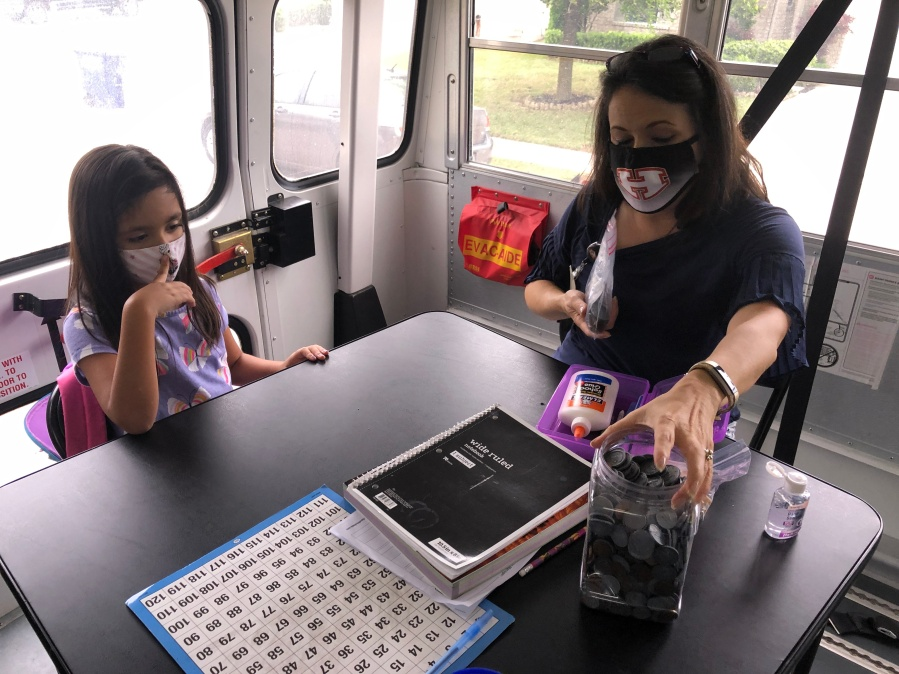 Karen Perez teaching one of her special education students inside Hutto ISD's school bus classroom (KXAN Photo/Chris Nelson)