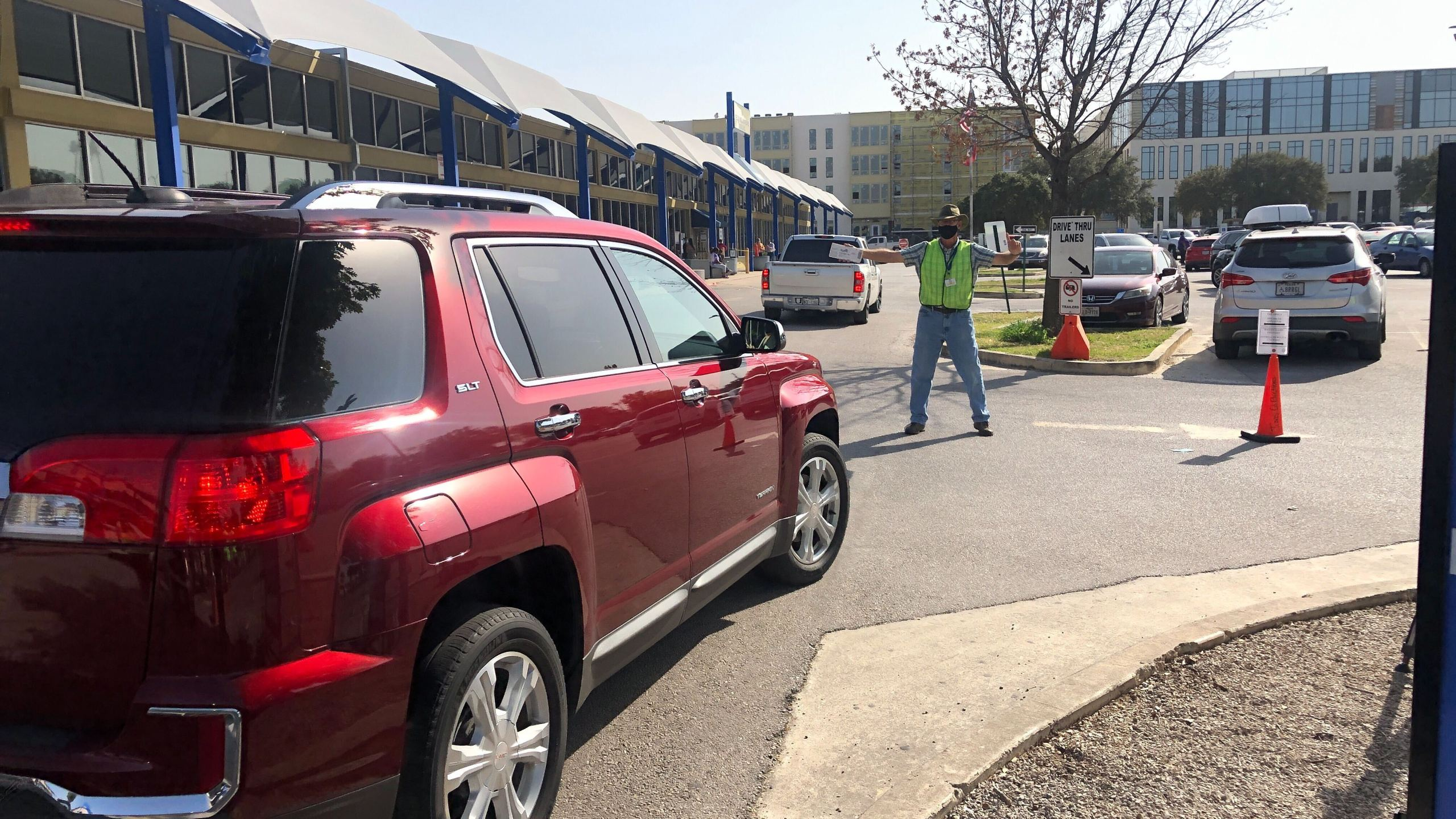 Drivers line up to hand deliver their mail-in ballots in Travis County Monday (KXAN/Frank Martinez)