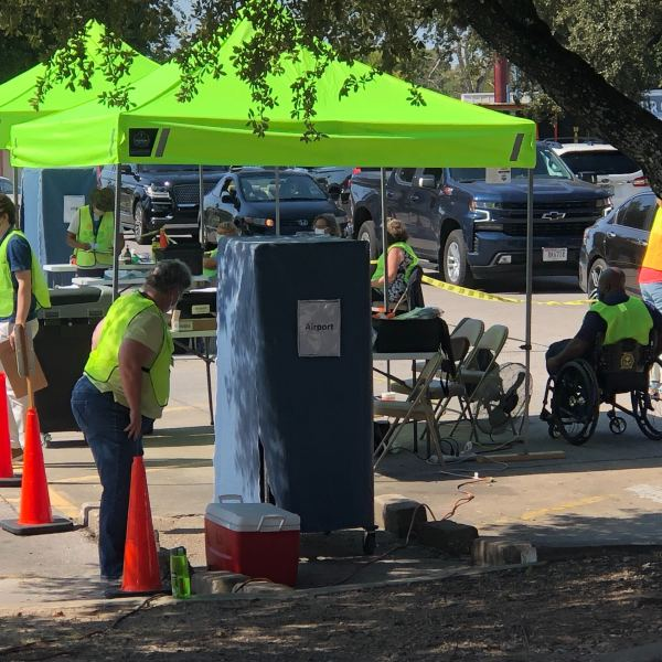People drive up to hand deliver their mail-in ballots on Airport Boulevard in Austin Oct. 5 (KXAN/Frank Martinez)