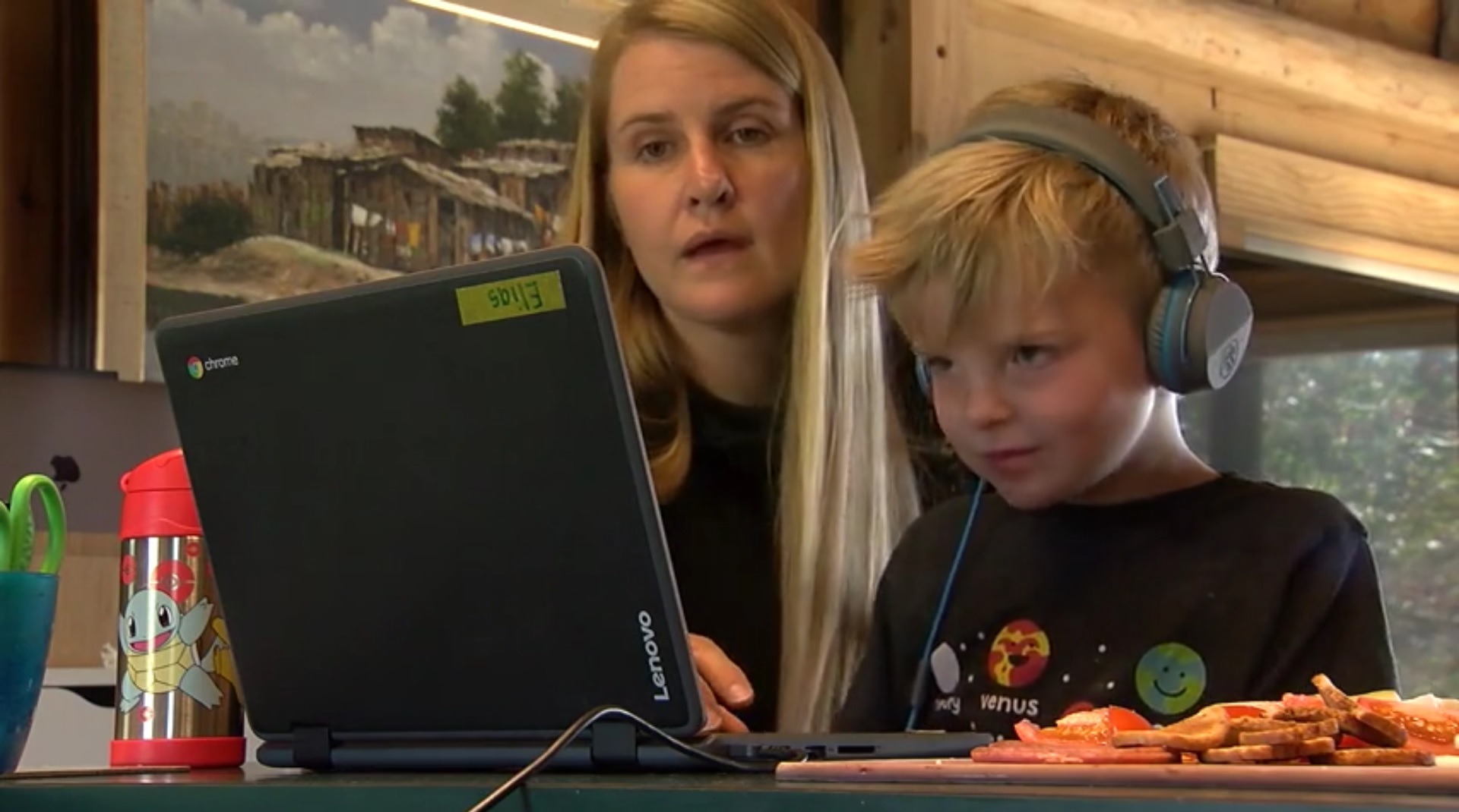 Erika Beers and her son work on online schooling (WHTM Photo)