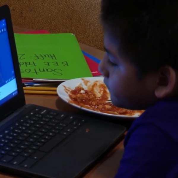 A student learns at home thanks to hotspots distributed by his school (WSPA Photo)