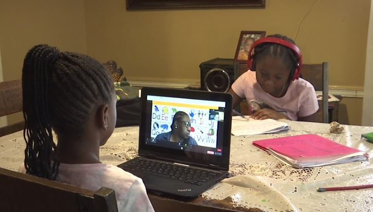 Londyn and Lyric study together at their dining room table (WIAT Photo)