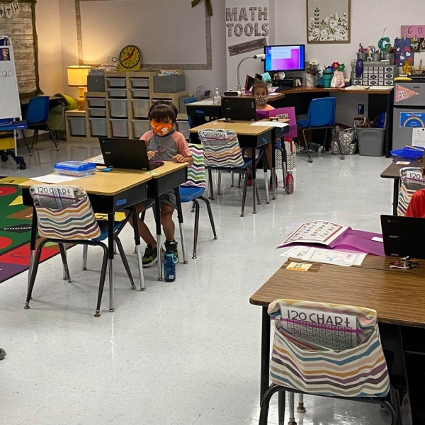 Students sit at desks spaced apart. (Courtesy: Thrall ISD)