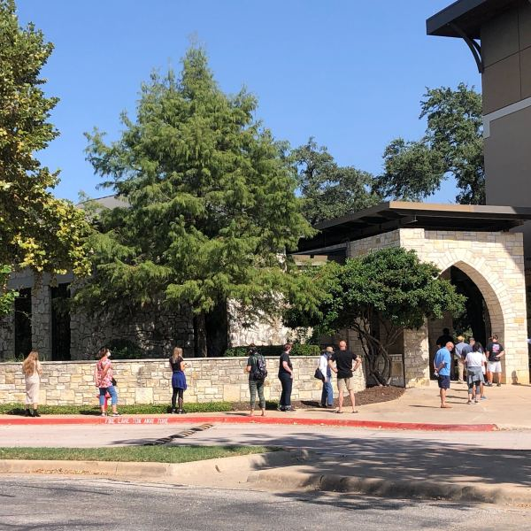Voters are seen here waiting in line at the Austin Oaks Church polling site on the first day of early voting. (KXAN Photo/Frank Martinez)