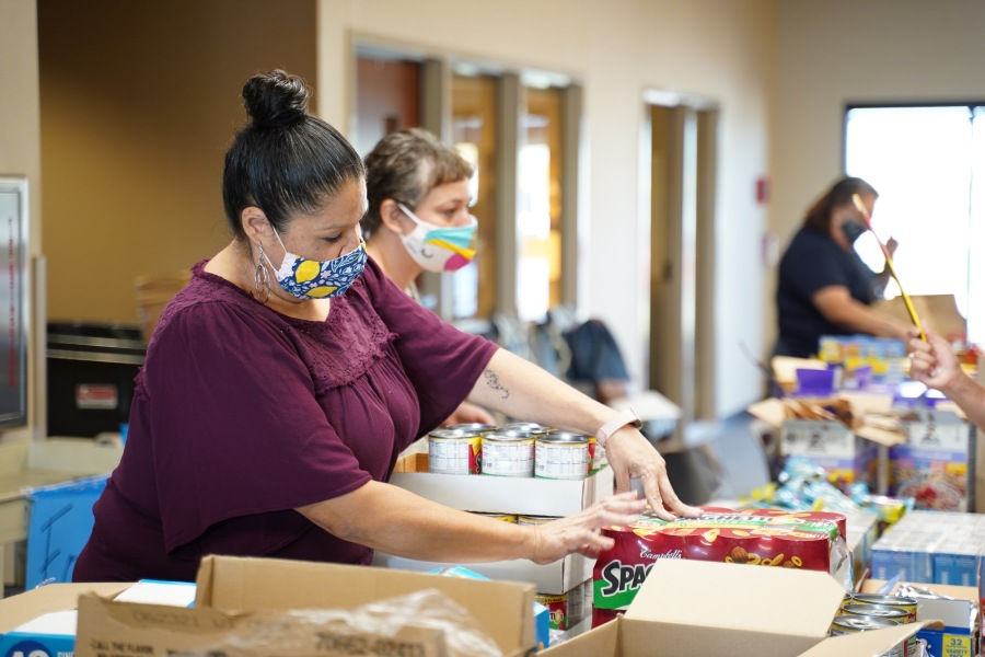 Workers help sort and distribute food to families in need in Manor, Texas (Courtesy Manor Schoolhouse Foundation)