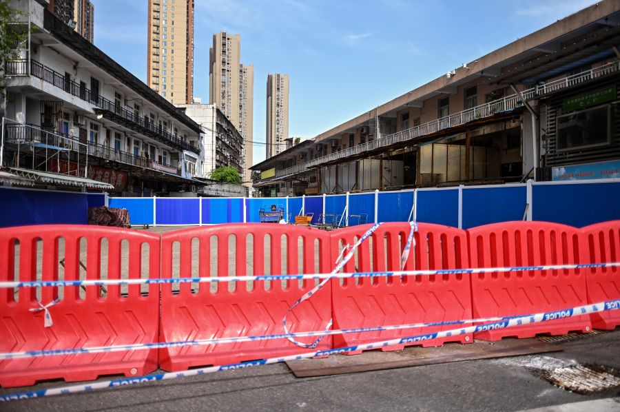 """This photo taken on April 15, 2020 shows barriers at the closed Huanan Seafood Market where the COVID-19 coronavirus is believed to have emerged in Wuhan in Chinas central Hubei province. - China's """"wet"""" markets have gained a bad international reputation as the coronavirus roiling the world is believed to have been born in stalls selling live game in Wuhan late last year. (Photo by HECTOR RETAMAL/AFP via Getty Images)"""