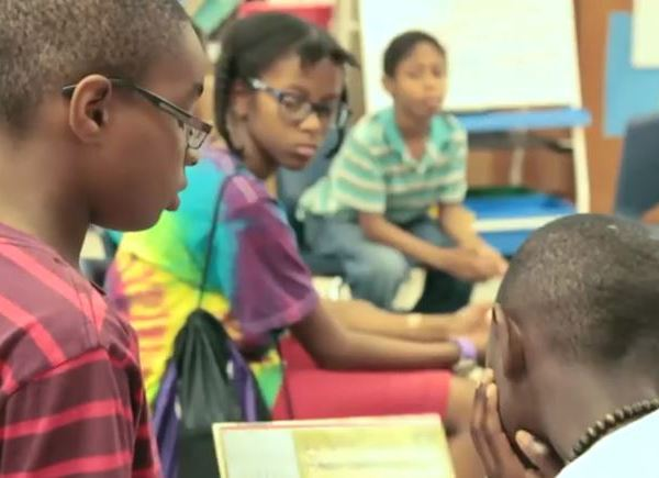 Students read to one another during a summer program before the COVID-19 pandemic (Courtesy Freedom Schools Austin)