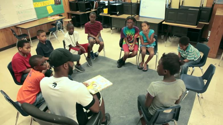 An adult reads to a group of children at Freedom Schools Austin before the pandemic (Courtesy Freedom Schools Austin)