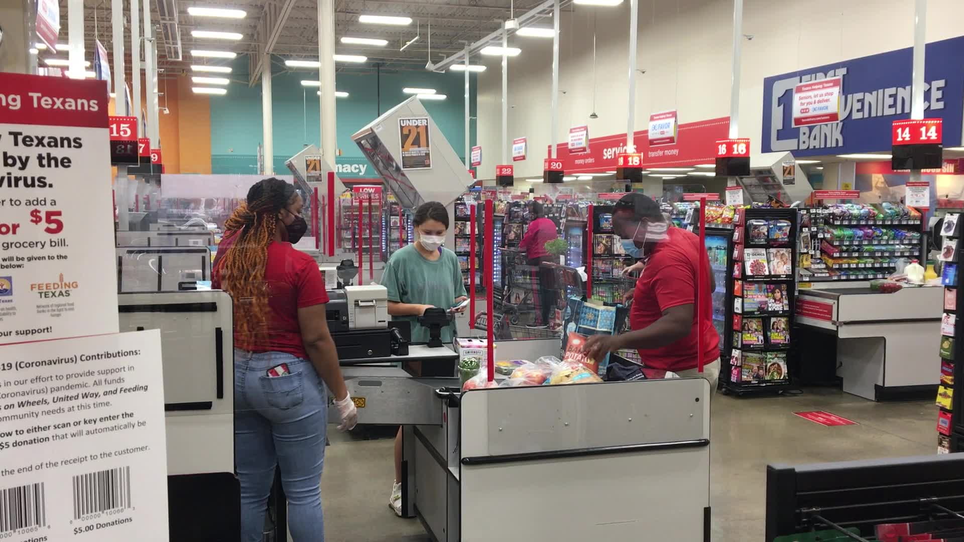 H-E-B implemented safety protocols including mandatory masks and plexiglass shields in March (KXAN Photo/Ryan Chandler)