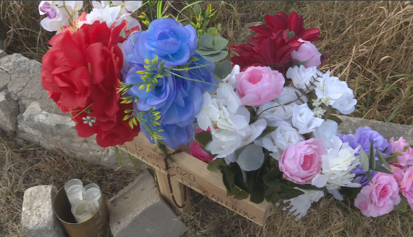 Family leaves cross and flowers at fatal hitandrun site