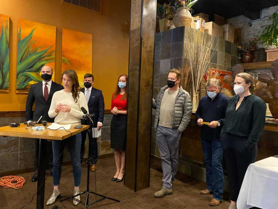 Austinites hold a press conference in opposition to the dine-in restaurant restrictions over the New Year holiday Dec. 31, 2020 (KXAN Photo/Kaitlyn Karmout)