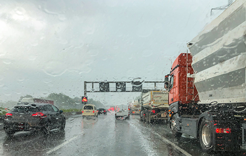 Heavy rain in traffic (Texas Mutual Sponsored Content)