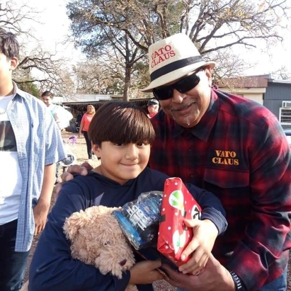 Vato Claus hands out Christmas gifts to Bastrop kids in 2019. (Source: Roland Nava)