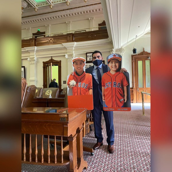 Rep. Armando Walle tweeted that he brought Houston Astros cutouts of his two sons to accompany him on the first day of the session.