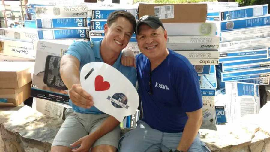 David Yeomans and Jim Spencer volunteer at the annual Fan Drive (KXAN Photo/Jim Spencer)