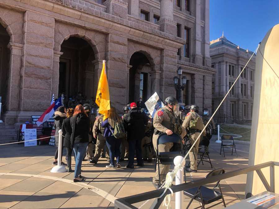 A handful of people protesting the COVID-19 vaccine on the Texas Capitol around 10:30 a.m. Jan. 12, 2020, the first day of the 87th Legislative session (KXAN Photo/Frank Martinez)