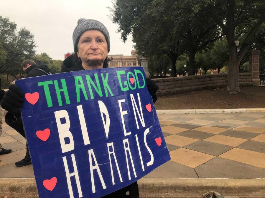 Irene Carrillo, president of North Shore Democrats of Travis County Club, holds a sign supporting Joe Biden and Kamala Harris outside the Texas Capitol Jan. 20, 2021 (KXAN Photo/Julie Karam)