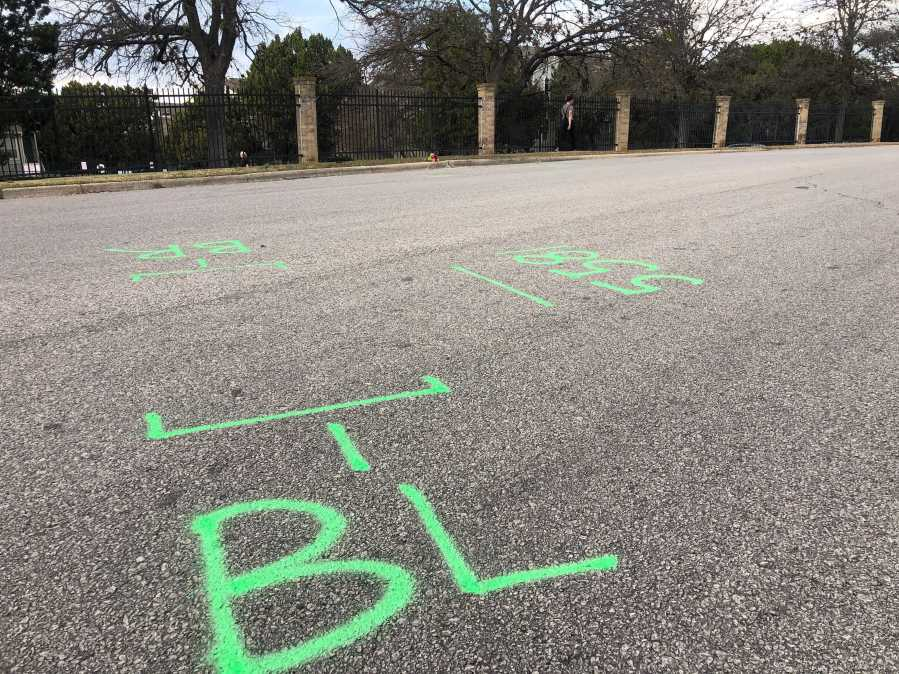 Markings on the road near where a man was shot and killed by police on Wickersham Lane Jan. 5, 2020 (KXAN Photo/Frank Martinez)