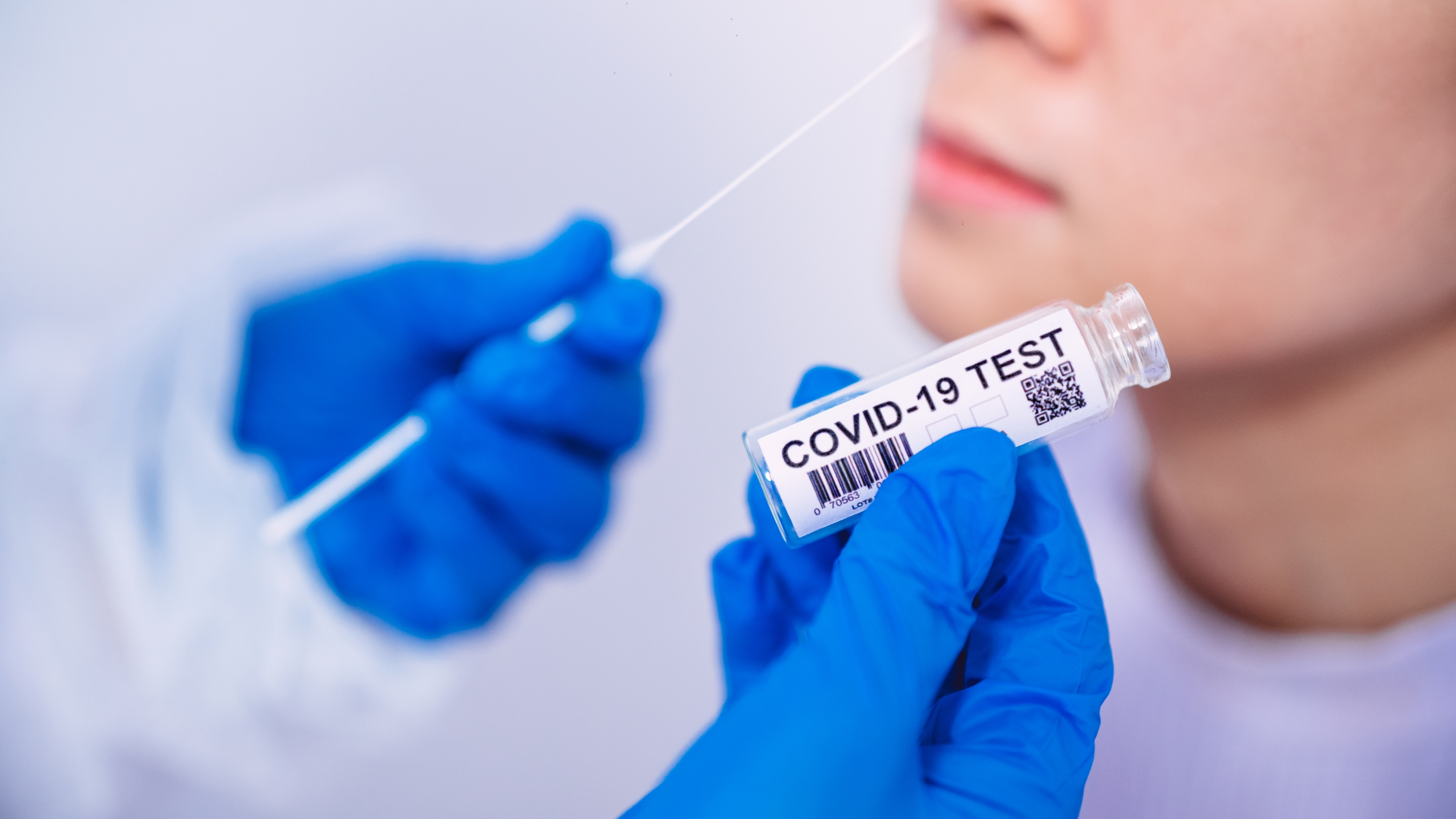 A person gets a nasal swab COVID-19 test (Getty Images)