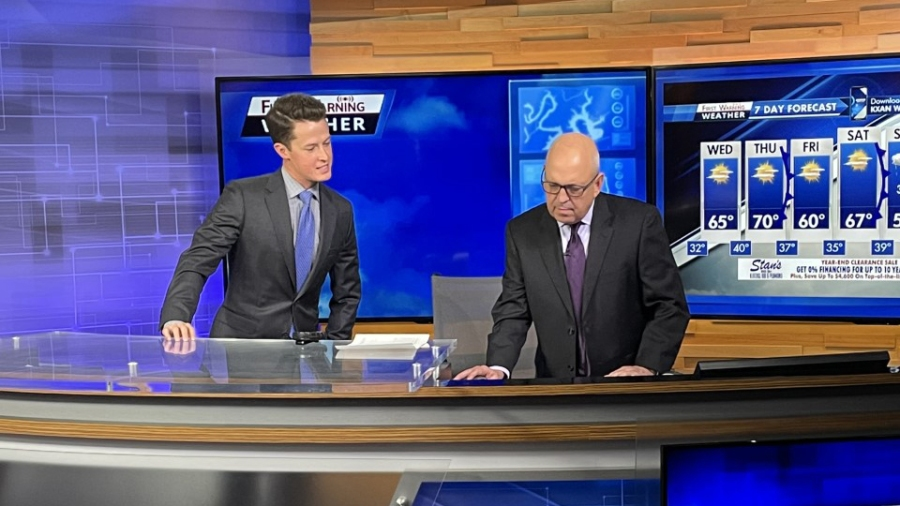 David Yeomans and Jim Spencer on the First Warning Weather desk (KXAN Photo/Rissie Wolfe)