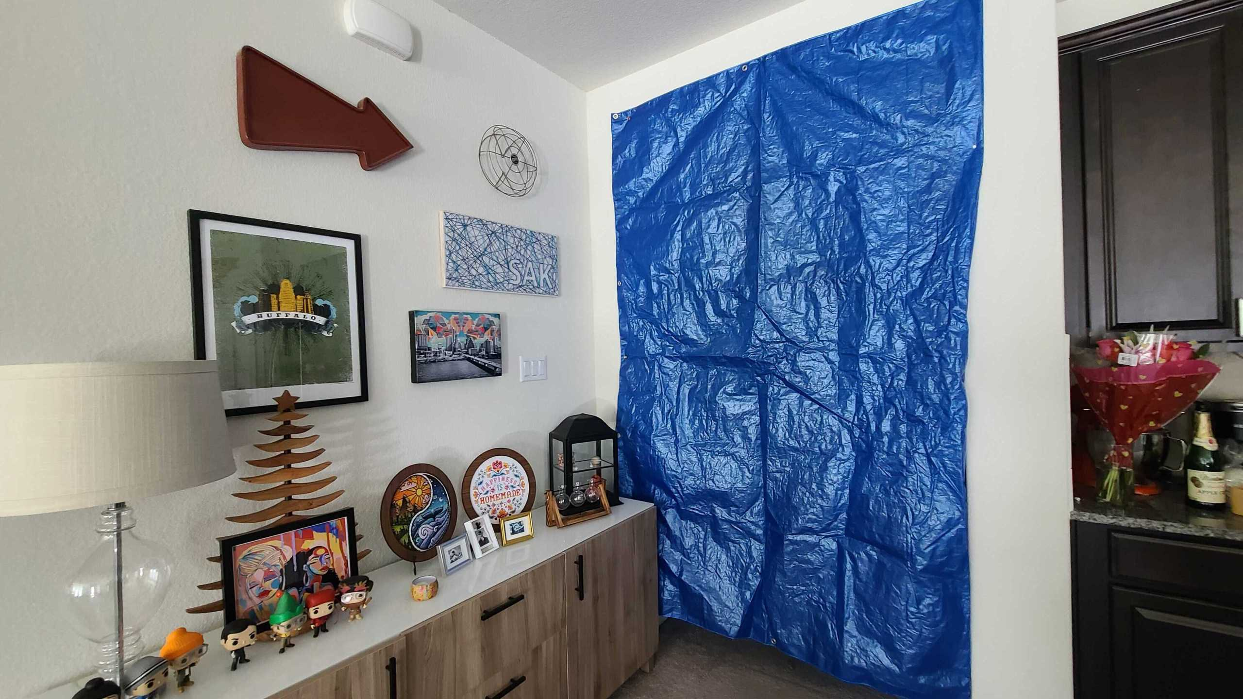 One way to keep heat in is to cover up windows and doorways in the room where you're hunkering down (KXAN Photo/Andrew Choat)