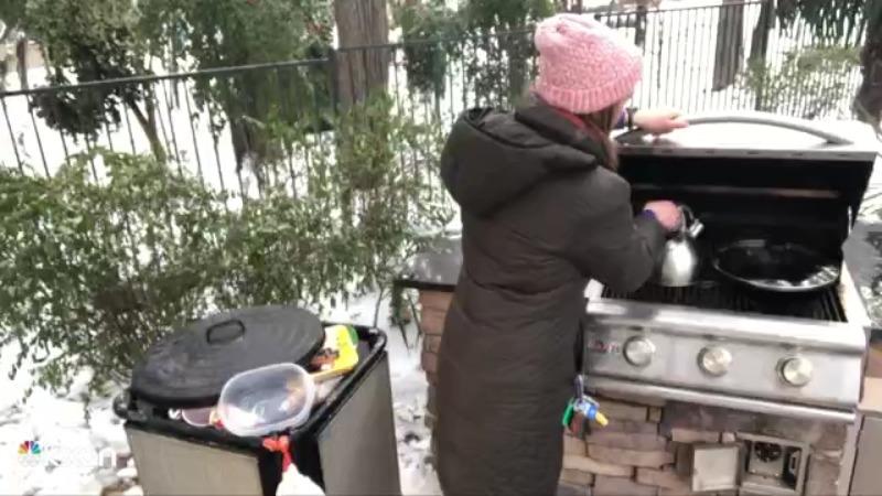 KXAN's Alyssa Goard boils water on her grill Feb. 18, 2021 (KXAN Photo/Alyssa Goard)