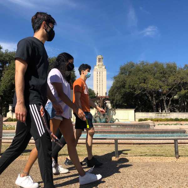 Students walk past the tower at the University of Texas at Austin campus on February 4, 2020. Some in-person classes resumed on campus this week after a pause at the start of the semester due to a surge in COVID-19 cases locally. (KXAN Photo/Alyssa Goard)
