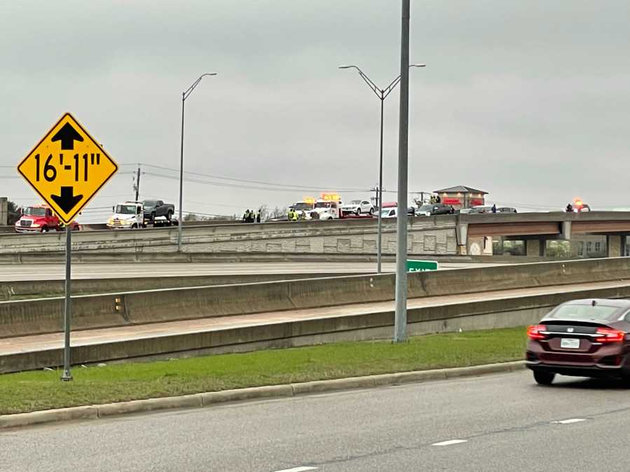 Cars being towed from a 26 car pileup on the overpass on eastbound N. State Highway 45 near Farm to Market Road 620. on Feb. 11, 2021 (KXAN Photo/Julie Karam)