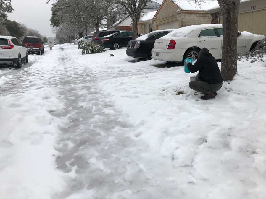 Trish Poulter in Pflugerville collects ice to help flush toilets Feb. 17, 2021 (KXAN Photo/Julie Karam)