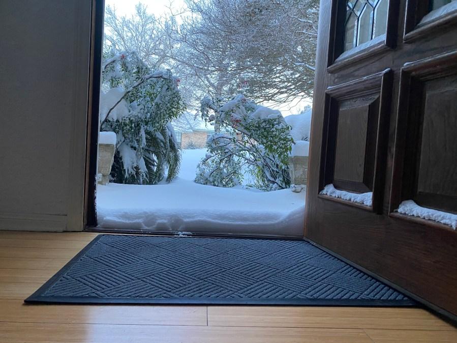 Northwest Austin snow piles at the front door Courtesy Deidre Harvego