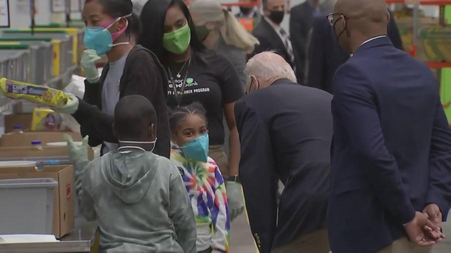 President Joe Biden greets some children volunteering at the Houston Food Bank Feb. 26, 2021 (Pool Photo)