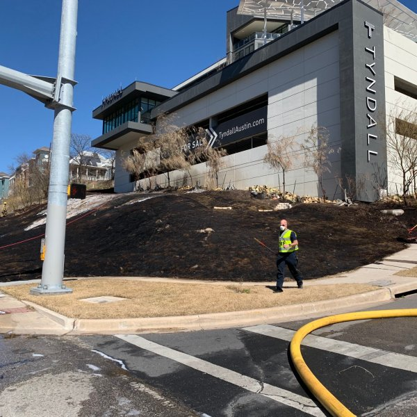 Grass fire in median near I-35 and East 8th Street in Austin March 5, 2021 (Austin Fire Department Photo)