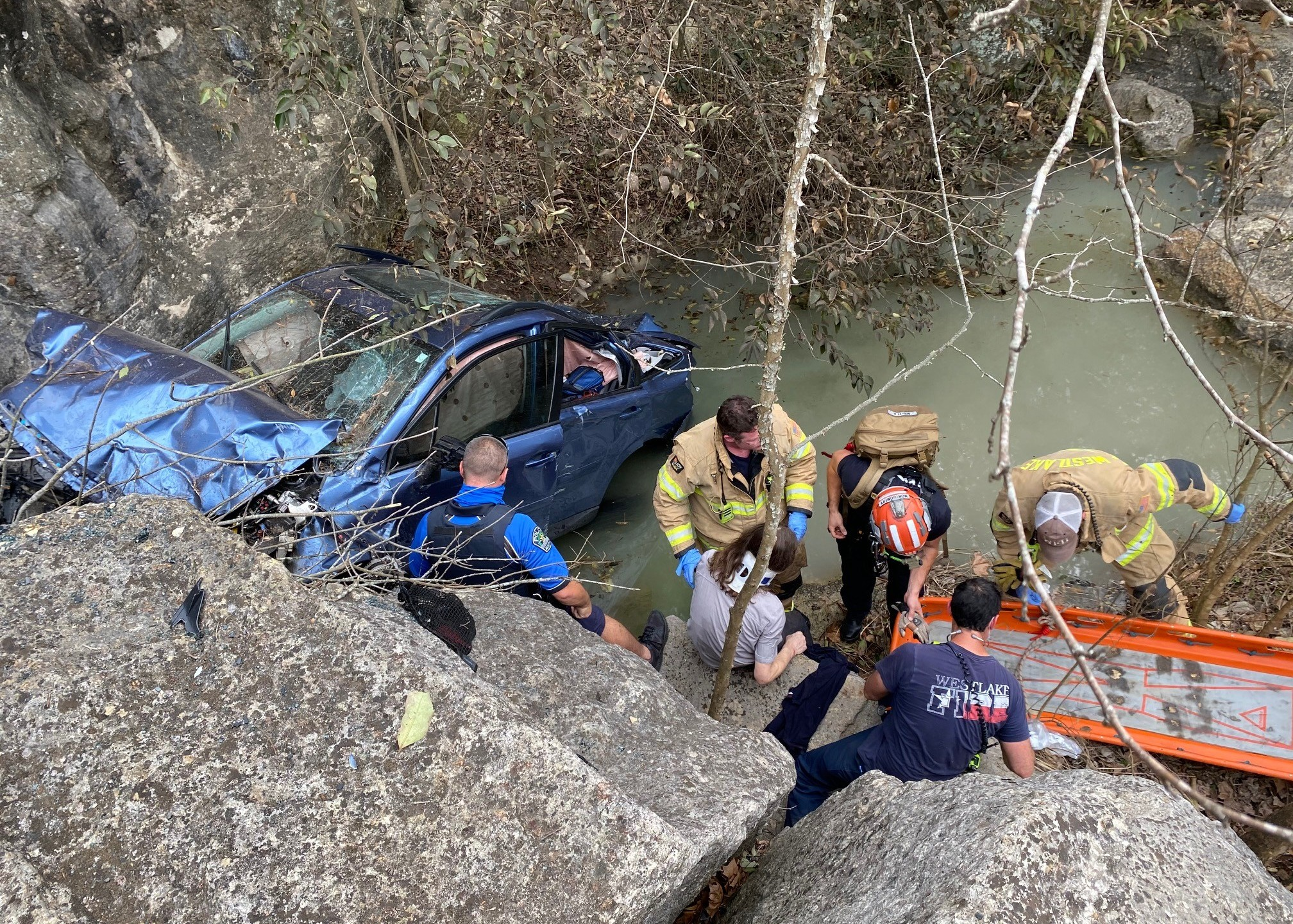 Vehicle crashes over embankment on Westlake Drive March 10 (ATCEMS Photo)