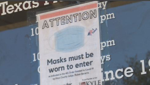 Business sign alerting customers they must be wearing a mask inside (KXAN/Jala Washington)