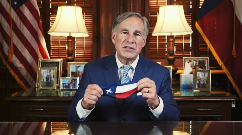 Gov. Greg Abbott holds up a mask during a video in which he announced a statewide mask mandate for Texas, on July 2, 2020. (Gov. Abbott Press Office)