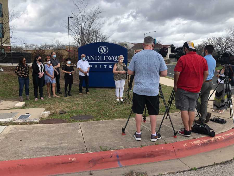 Small business against the City of Austin's purchase of Candlewood Suites off Pecan Park Boulevard gather to announce lawsuit on March 12, 2021 (KXAN/Frank Martinez)