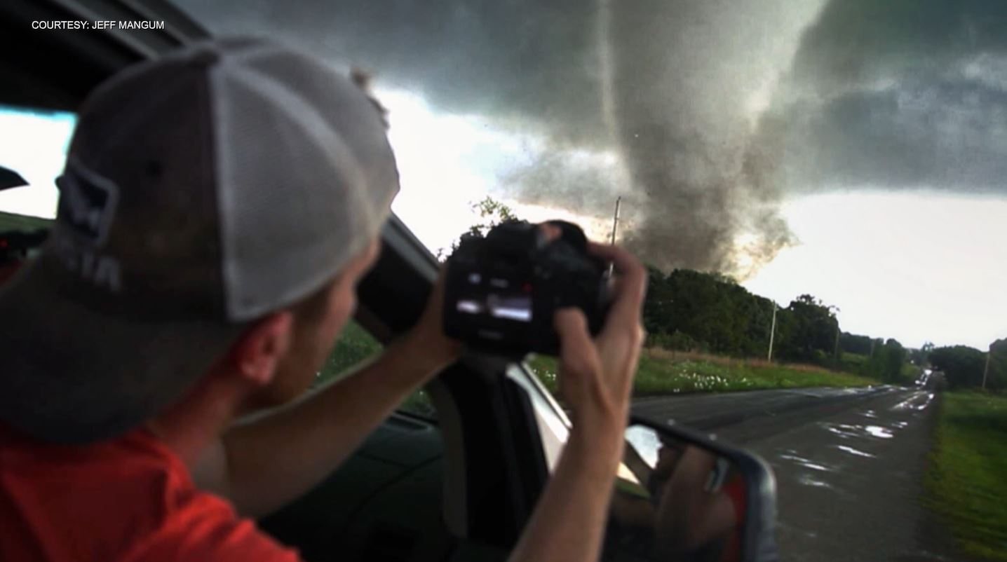 A storm chaser photographs a tornado (Courtesy Jeff Mangum)