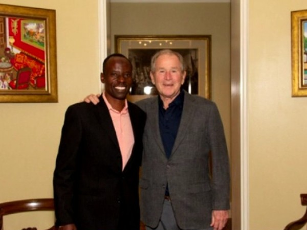 Austin philanthropist Gilbert Tuhabonye with former President George W. Bush. Tuhabonye was featured in Bush's new book highlighting immigrants.