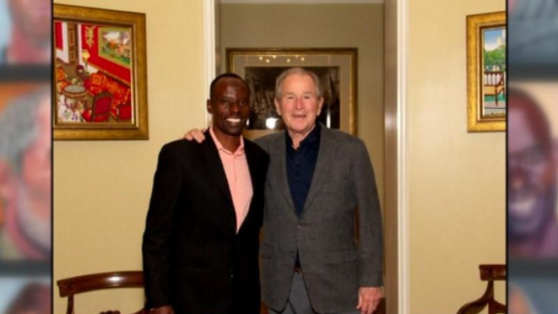 Austin philanthropist Gilbert Tuhabonye with former President George W. Bush. Tuhabonye was featured in Bush's new book highlighting immigrants.